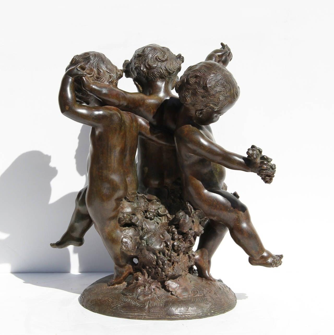 Three Putti - Gold Figurative Sculpture by Affortunato Gory
