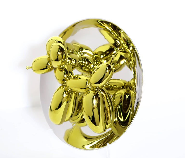 Artist: Jeff Koons, American (1954 - ) Title: Balloon Dog (Yellow) Year: 2015 Medium: Porcelain with Mirror Finish, signed and numbered verso Edition: 2300 Size: 10.5 x 10.5 x 5 in. (26.67 x 26.67 x 12.7 cm) Includes all original packaging.