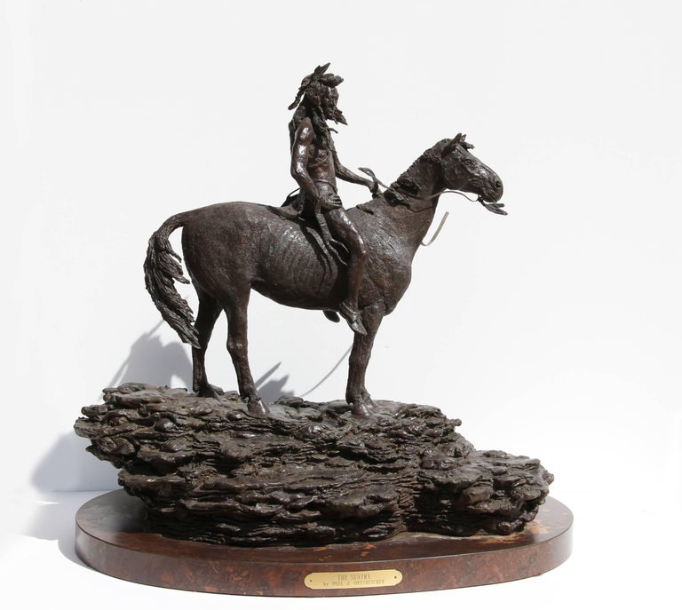 Artist: Paul Oestreicher, American Title: The Sentry Year: 1985 Medium: Bronze Sculpture, signature inscribed Edition: 3/6 Size: 22.5 in. x 23 in. x 16 in. (57.15 cm x 58.42 cm x 40.64 cm) Base 1.75 inches tall  This is a sold, heavy bronze