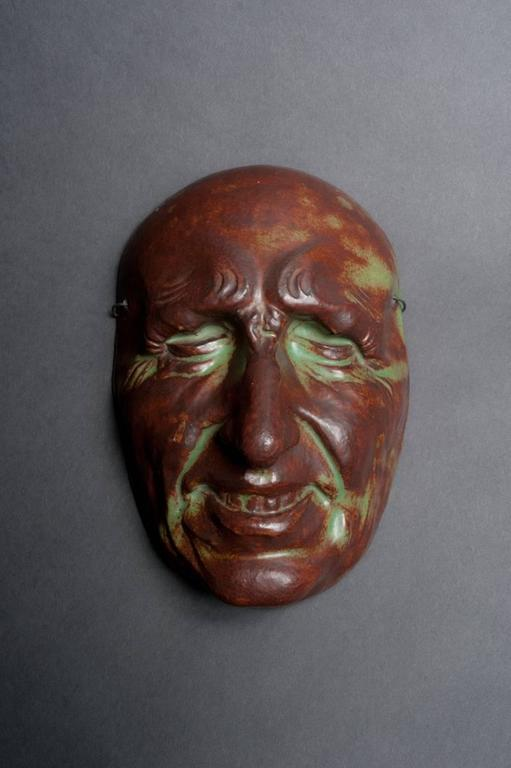 Exploring new firing and glazing techniques and their myriad effects on traditional forms was an exciting approach for many experimental turn-of-the-century ceramists. Here the acid green and dark umber glaze takes on the quality of copper patina.