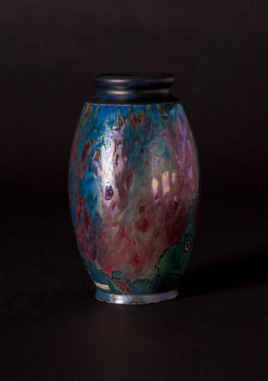 During his time as Artistic Director of Montieres in Amiens, Jean Barol's work was often characterized by an exploration of techniques such as sgraffito, and barbotine slip as well as enameled cloisonne against iridescent luster glazes. Upon his