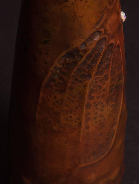 LUDWIG VIERTHALER FOR J. WINEHART & CO., ART NOUVEAU CICADA COPPER VASE, c. 1906, the cylindrical form narrowing upwards is decorated with a single inset opal. Surrounding this stone is a naturalistic rendering in repousse of a cicada further