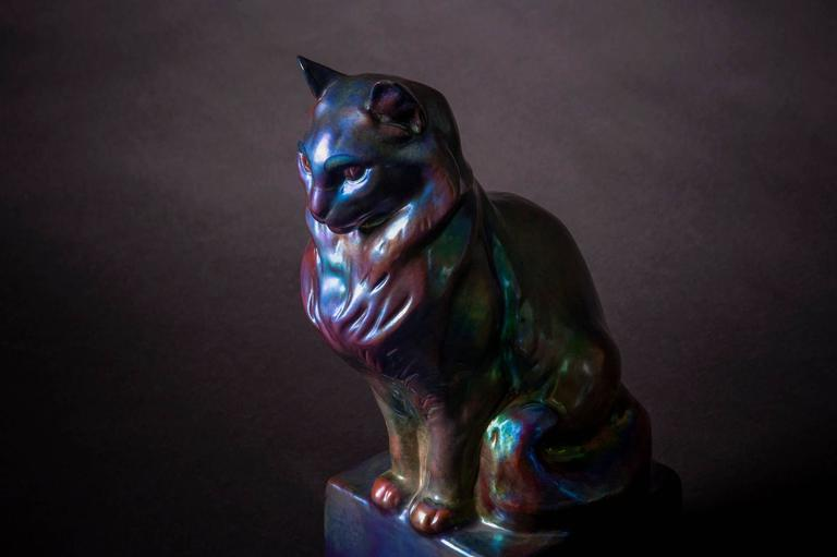 "SYMBOLIST CAT by ZSOLNAY, eosin glazed porcelain.  ""It is easy to understand why the rabble dislike cats. A cat is beautiful; it suggests ideas of luxury, cleanliness, voluptuous pleasures.""  - Charles Baudelaire  Iridescence, which"
