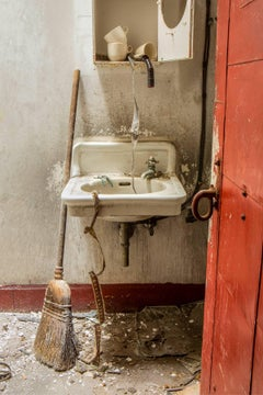 """Dirty Film"", Rebecca Skinner, color photo, abandoned, theater, sink, broom, red"