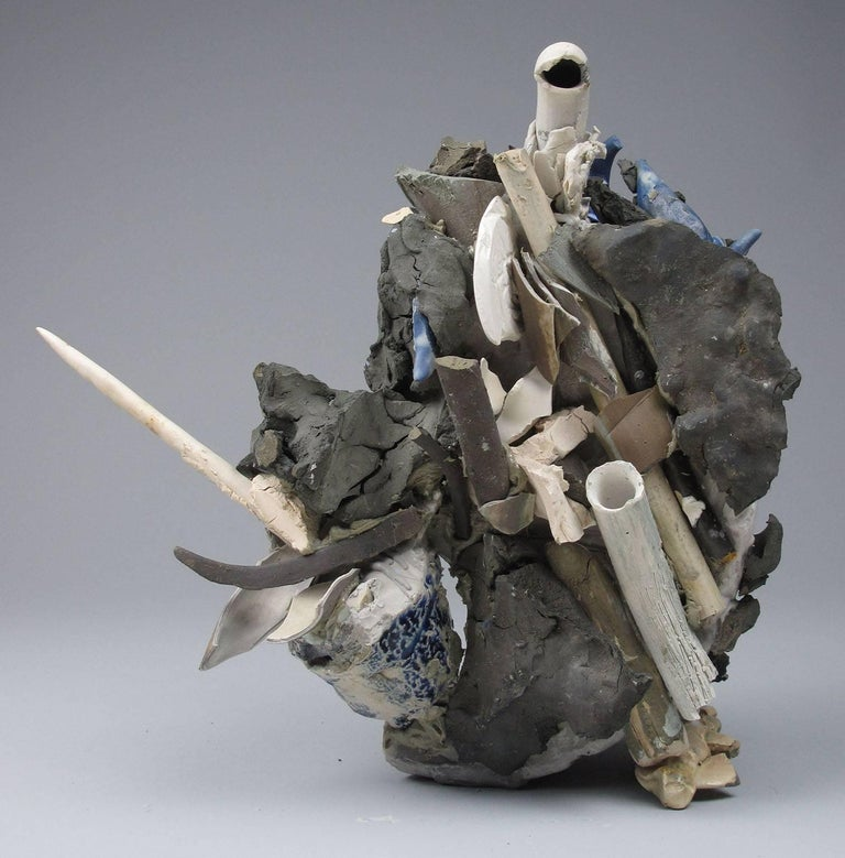 """Sara Fine-Wilson's """"Coming Up for Air"""" is a mixed media sculpture of multiple ceramic elements that were previously formed, fired, and glazed and then incorporated into this cast plaster, metal, glass and ceramic construction. The 13 x 13 x 6 inch"""