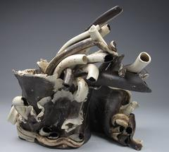"""""""Dense Arc"""", abstract ceramic sculpture in white and browns with hints of cobalt"""