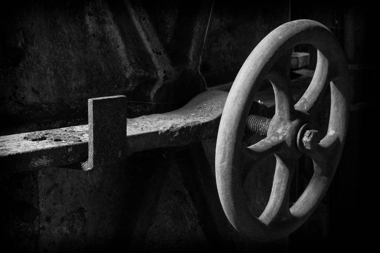 """Wheel"", Rebecca Skinner, abandoned silk mill, metal print, industrial, vintage - Photograph by Rebecca Skinner"