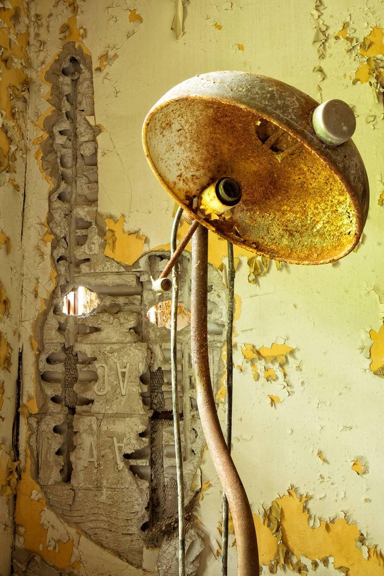 """Aged"", Rebecca Skinner, color photo, metal print, abandoned, yellow, lamp - Photograph by Rebecca Skinner"