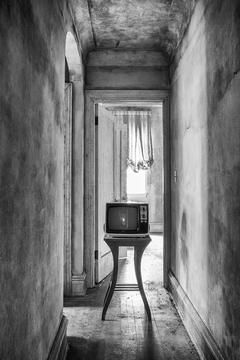 """""""Show Time"""", Rebecca Skinner, television, hallway, abandoned, home, black, white - Photograph by Rebecca Skinner"""
