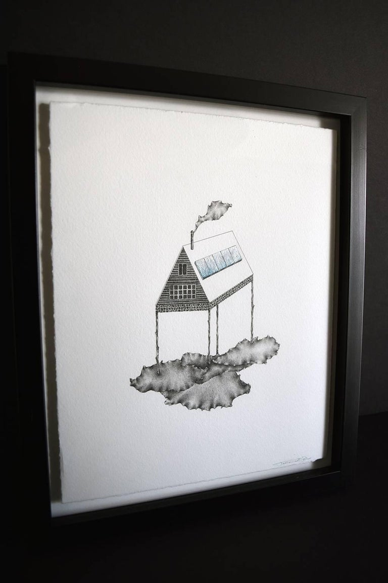 "Tatiana Flis' ""Cloud Minder"" is a minutely detailed 8 x 10 inch graphite and gouache drawing of a fantastical landscape. Ice blue and shimmering silver solar panels line the roof of an A-frame house. A cloud of smoke rises from the chimney, which"