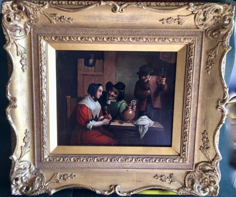 17th century style Dutch figures in an Inn drinking at a table