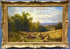 English Harvest scene with corn stacks and wild flowers