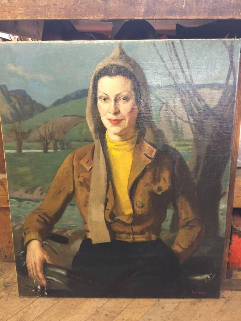 English portrait of a lady from the 1930's with a bicycle in a flying jacket - Painting by John Gilroy