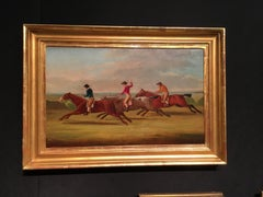 English horse racing scene with three horses and jockeys in mid gallop