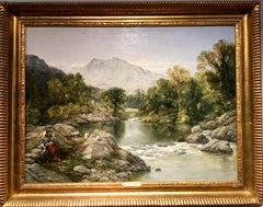 Extensive River landscape in Wales with a lady and her dog seated by the river