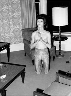 Bowie Praying on Knees