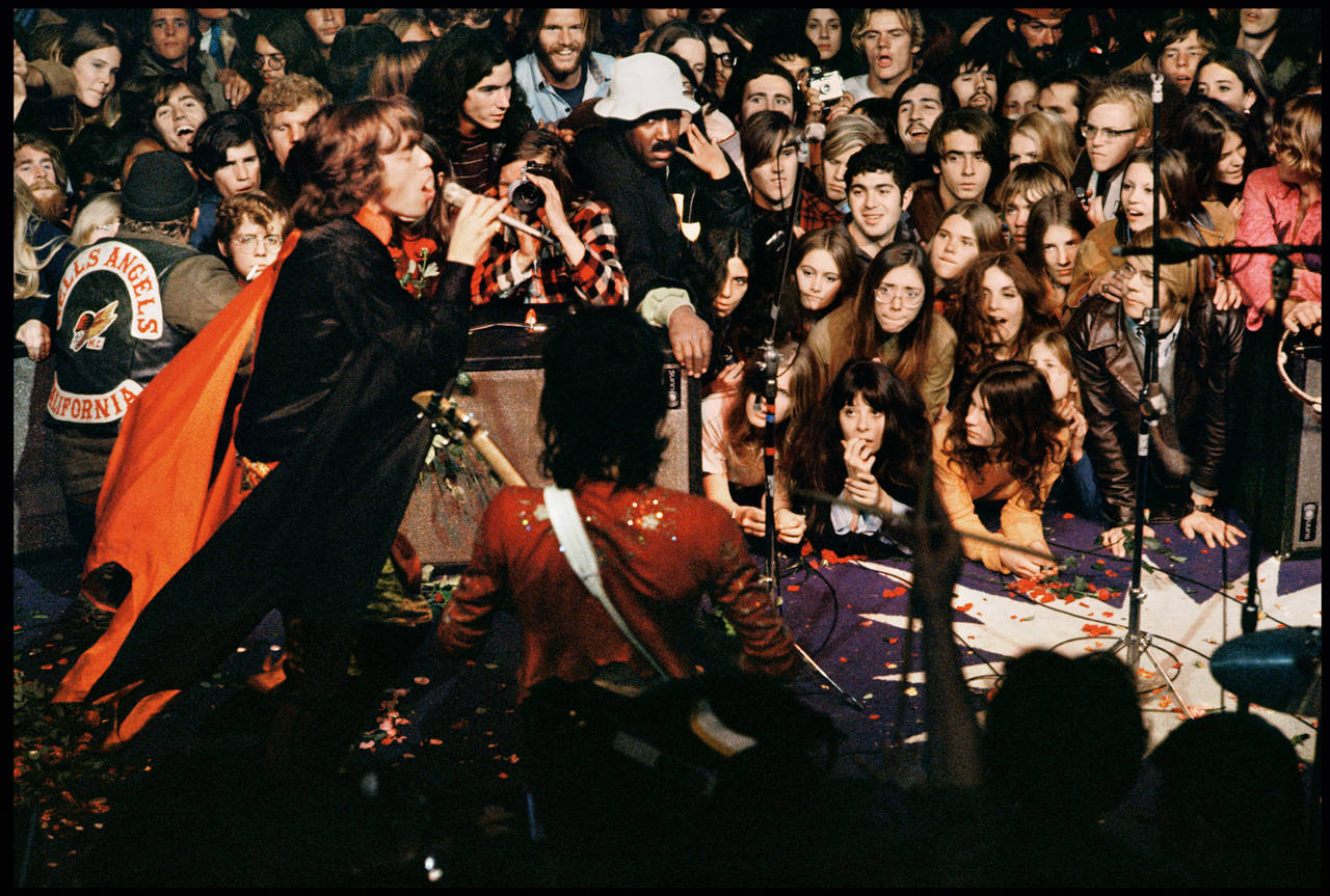 Ethan Russell Color Photograph - Mick Jagger On Stage at Altamont, December