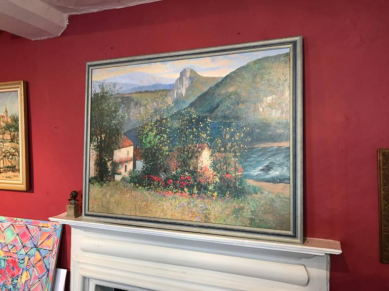 Superb French Impressionist oil painting depicting this beautiful landscape with river gorge or estuary behind. The fields are full of wild flowers and poppies, set against old stone cottages.   The painting is signed by the artist to the lower
