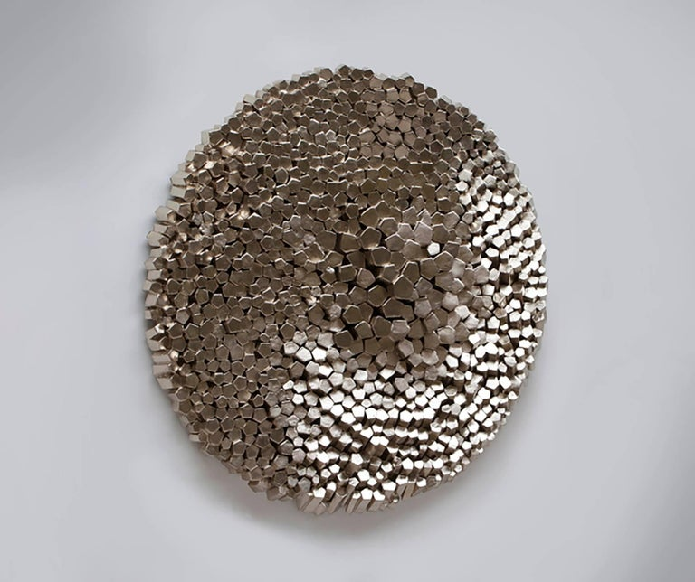 Staffa is a luxury, museum quality piece handmade out of 837 hand cut pieces of rigid insulating board glued on a plywood base, covered with epoxy resin and gilded with caplain gold leafs, a composite of palladium and 24k gold. This modern abstract