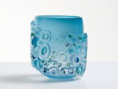 Murano glass style blue vase. Blue blown glass vessel with glass ornaments