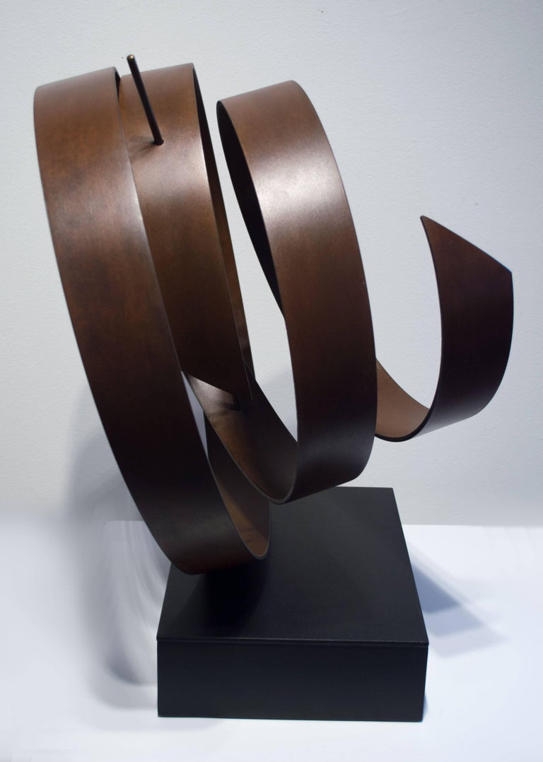 """Olympiad. Hand fabricated steel with patina, bronze rod. Unique, one of a kind. 19 x 19 x 14"""" sculpture. Powder coated steel base, 3""""h, 12""""w, 9""""d.  There are two sides to any circle: the inside and the outside. In a similar way,"""