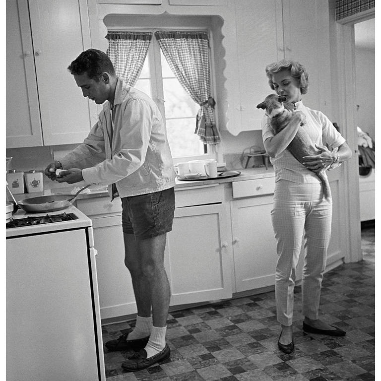 Sid Avery Black and White Photograph - Paul Newman and Joanne Woodward in the Kitchen of their Beverly Hills Home
