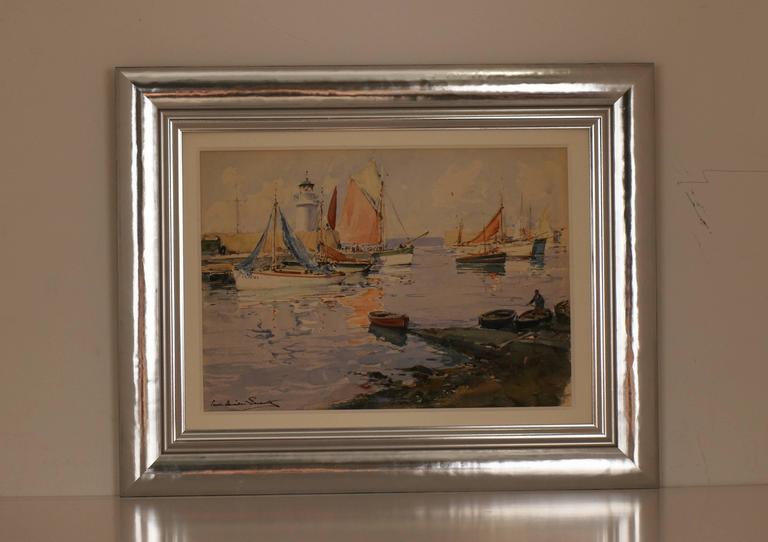 Original signed watercolor by noted French artist Paul-Emile Lecomte. Shows a sunlit French harbor scene with lighthouse and an assortment of boats.   As a young artist Lecomte developed his ability in concert with a large extended family of noted