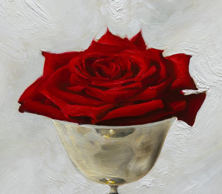 Realist still-life with red rose in silver cup,