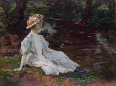 Young beauty resting on the riverbank