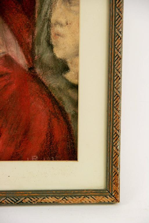 #5-2437 A male portrait ,pastel on paper set in a mat under glass ,displayed in a wood frame.Wear on the frame