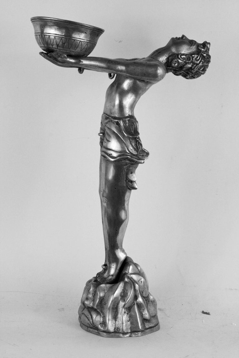 9-098 Deco sculpture  with outstretched arms supporting a vessel