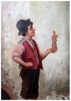 Young Boy Holding a Statue