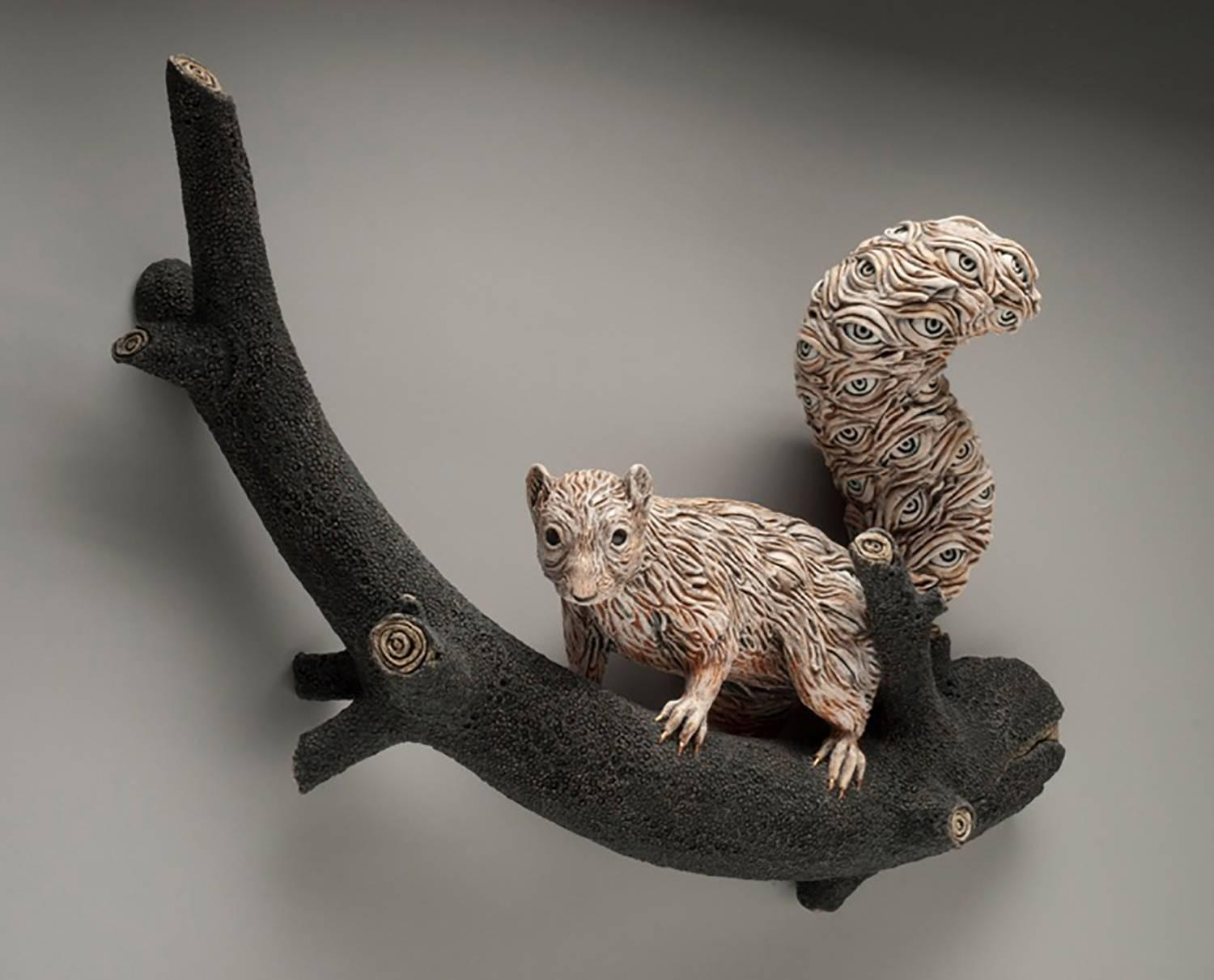 AWARENESS - hand-built ceramic sculpture of squirrel with many eyes in body