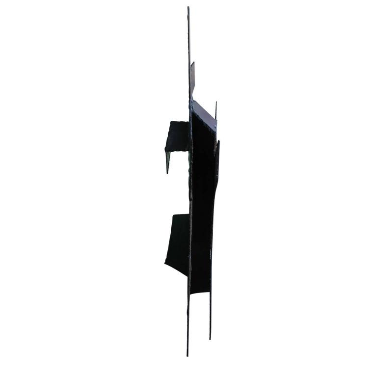 Black Steel wall sculpture in a minimal style by Houston artist George Smith.   Artist Biography: Born in Buffalo, NY, Smith received a B.F.A. in Sculpture from the San Francisco Art Institute in 1969. In 1972, he received an M.A. in Sculpture from
