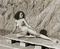 Andre de Dienes - Nude on Stone Bench