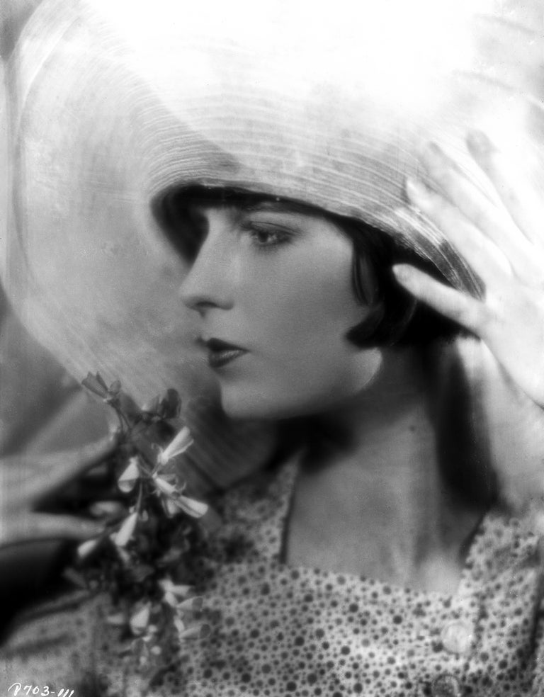Louise Brooks was an American dancer and actress during the 1920's and 1930's.  She is noted for popularizing the bobbed haircut.  This image was captured by photographer Eugene Robert RIchee and is credited to Globe Photos.  This is a limited