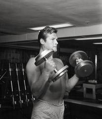 Shirtless Roger Moore Pumping Iron Fine Art Print