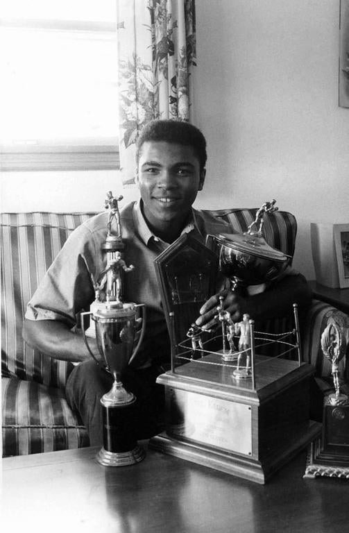 Unknown black and white photograph muhammad ali posed with his trophies fine art print