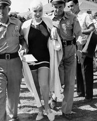 Marilyn Monroe in Swimsuit Escorted by police From Fans