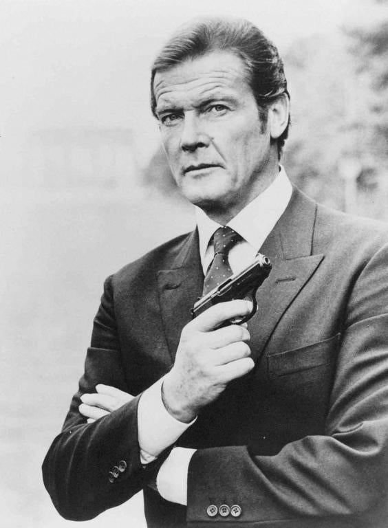 Roger Moore as James Bond 007 with Walther PPK
