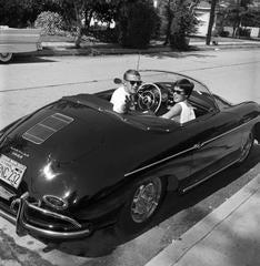Steve McQueen with wide Niele Adams in his beloved Porsche