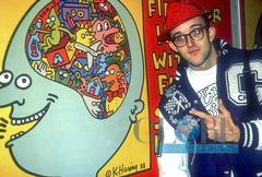 Keith Haring Pointing to One of His Paintings