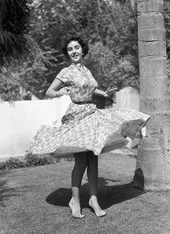 Elizabeth Taylor Spinning on Lawn