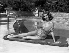 Rita Hayworth Sunbathing Poolside Fine Art Print