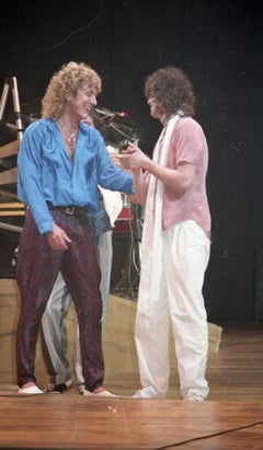Robert Plant and Jimmy Page Performing Live on Stage