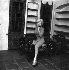 Jayne Mansfield Seated with Bookshelves Fine Art Print