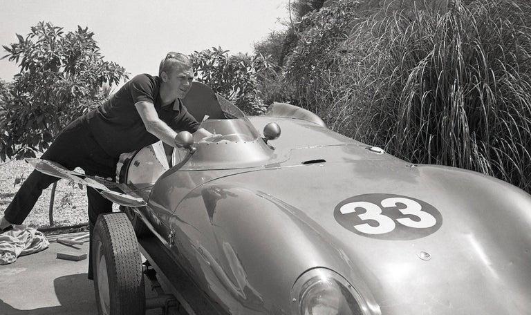 Steve McQueen on the Side of His Porsche Fine Art Print