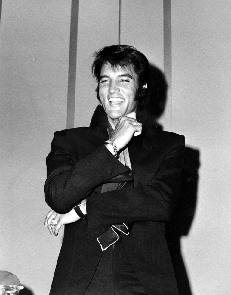 Phil Roach Black and White Photograph - Elvis Laughing at a Press Conference