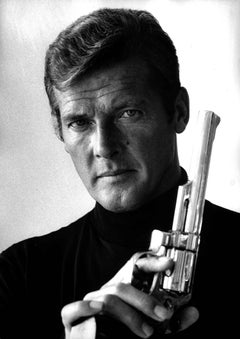 Roger Moore With Gun Fine Art Print