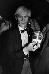 Andy Warhol autographing a Campbells soup can